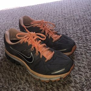 Grey and orange Nike tennis shoes